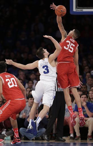 Utah forward Kyle Kuzma (35) blocks a shot by Duke guard Grayson Allen (3) during the second half of an NCAA college basketball game, Saturday, Dec. 19, 2015, in New York. Utah won 77-75 in overtime. (AP Photo/Julie Jacobson)