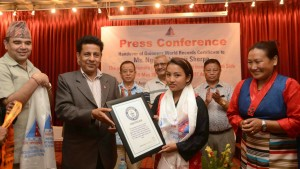 Ngim Sherpa is given a her world record certificate during the official presentation ceremony. Location and date not specified. | Photo courtesy Ngim Sherpa, St. George News