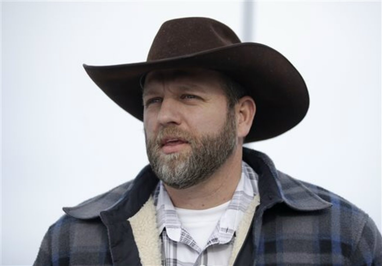 """Ammon Bundy, one of the sons of Nevada rancher Cliven Bundy, speaks with reporters during a news conference at Malheur National Wildlife Refuge headquarters Monday, Jan. 4, 2016, near Burns, Ore. The group calls itself Citizens for Constitutional Freedom and has sent a """"demand for redress"""" to local, state and federal officials. Armed protesters took over the Malheur National Wildlife Refuge on Saturday after participating in a peaceful rally over the prison sentences of local ranchers Dwight and Steven Hammond, Malheur National Wildlife Refuge, Oregon, Jan. 4, 2016 