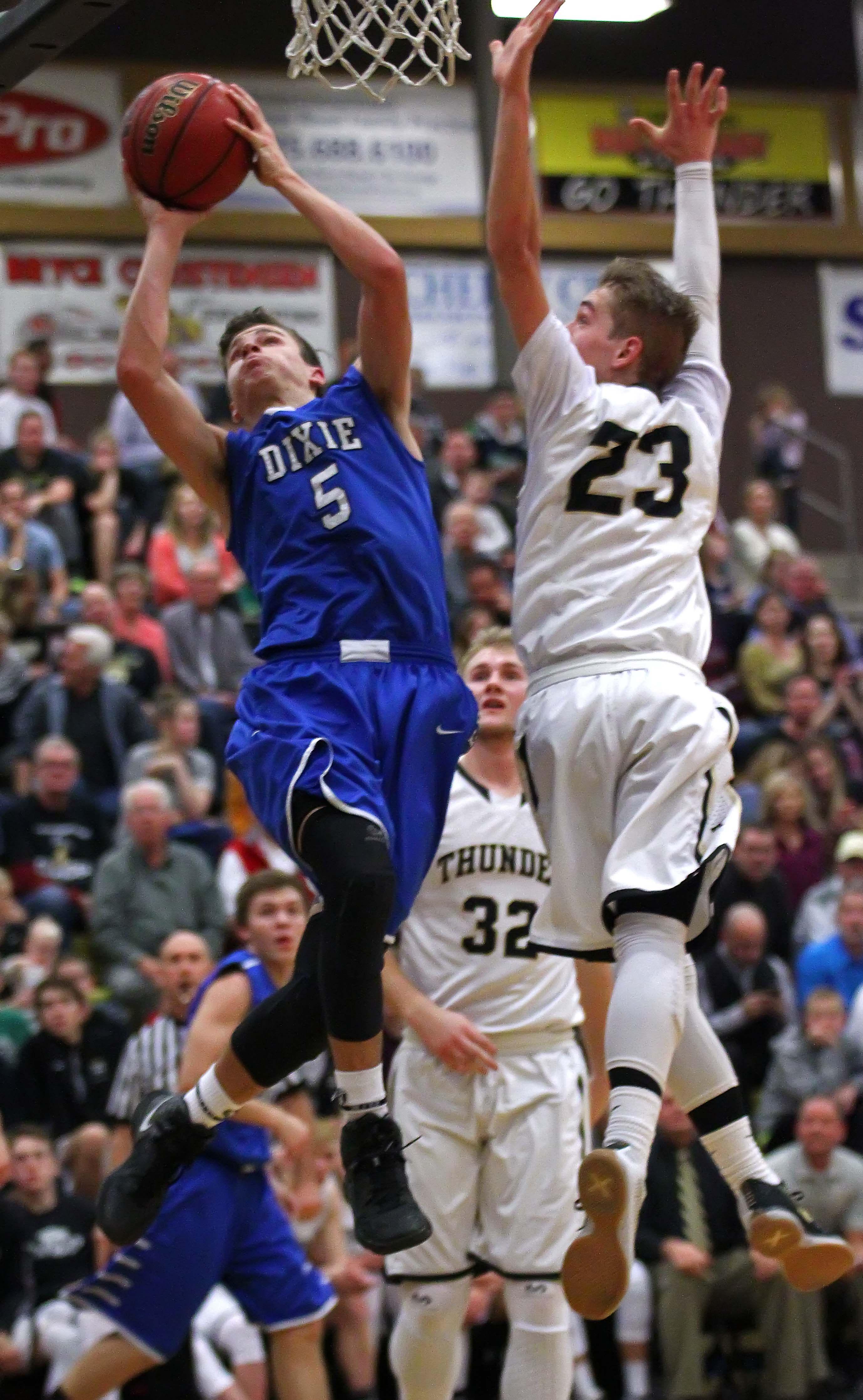Dixie's Tyler Bennett (5) and Desert Hills' Logan Hokanson (23), Desert Hills vs. Dixie, Boys Basketball, St. George, Utah, Jan. 20, 2016, | Photo by Robert Hoppie, ASPpix.com, St. George News