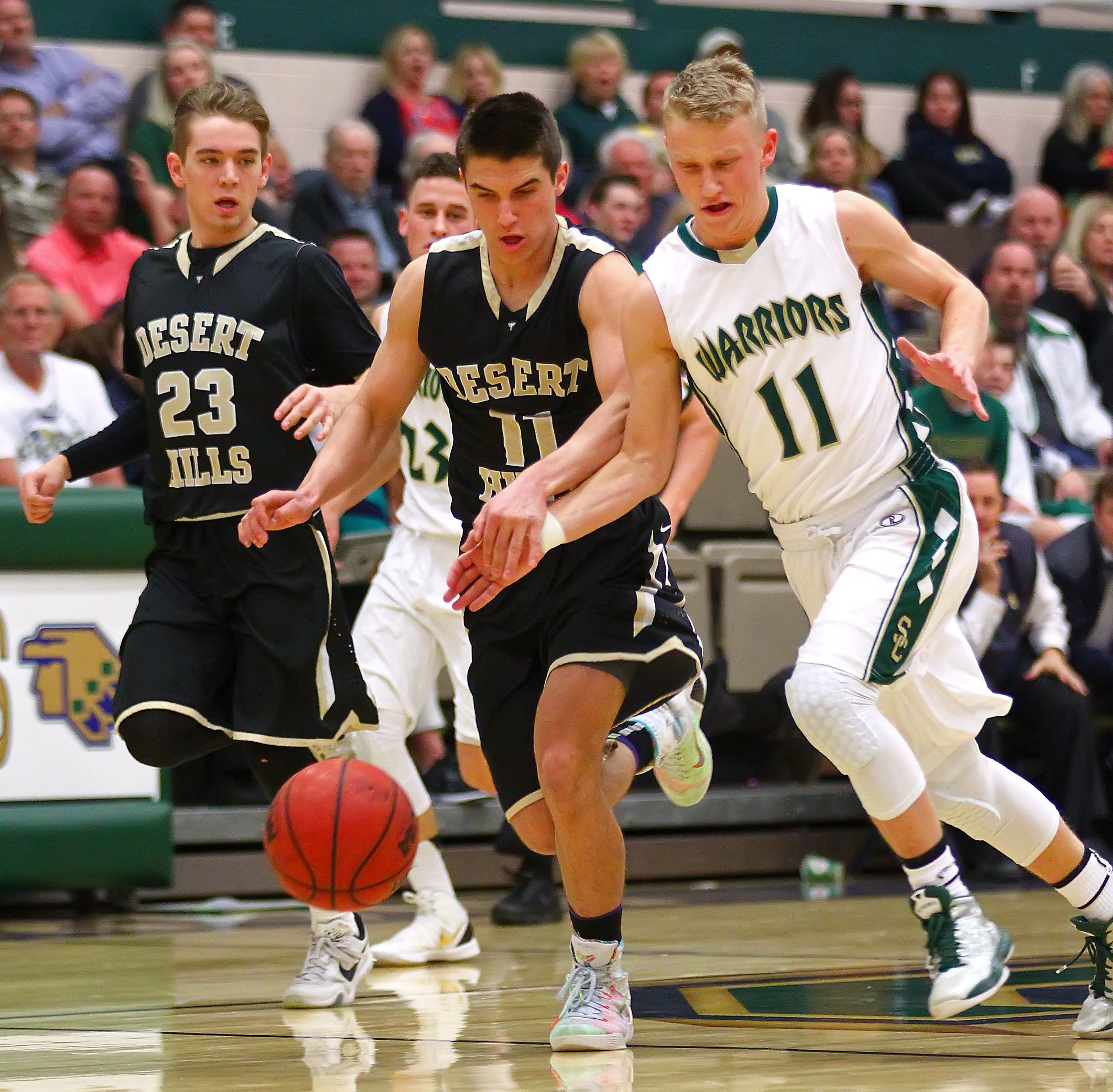 Snow Canyon's Caeden Barney (11) and Desert Hills' Tyler Simister (11), Snow Canyon vs. Desert Hills, Boys Basketball, St. George, Utah, Jan. 27, 2016, | Photo by Robert Hoppie, ASPpix.com, St. George News