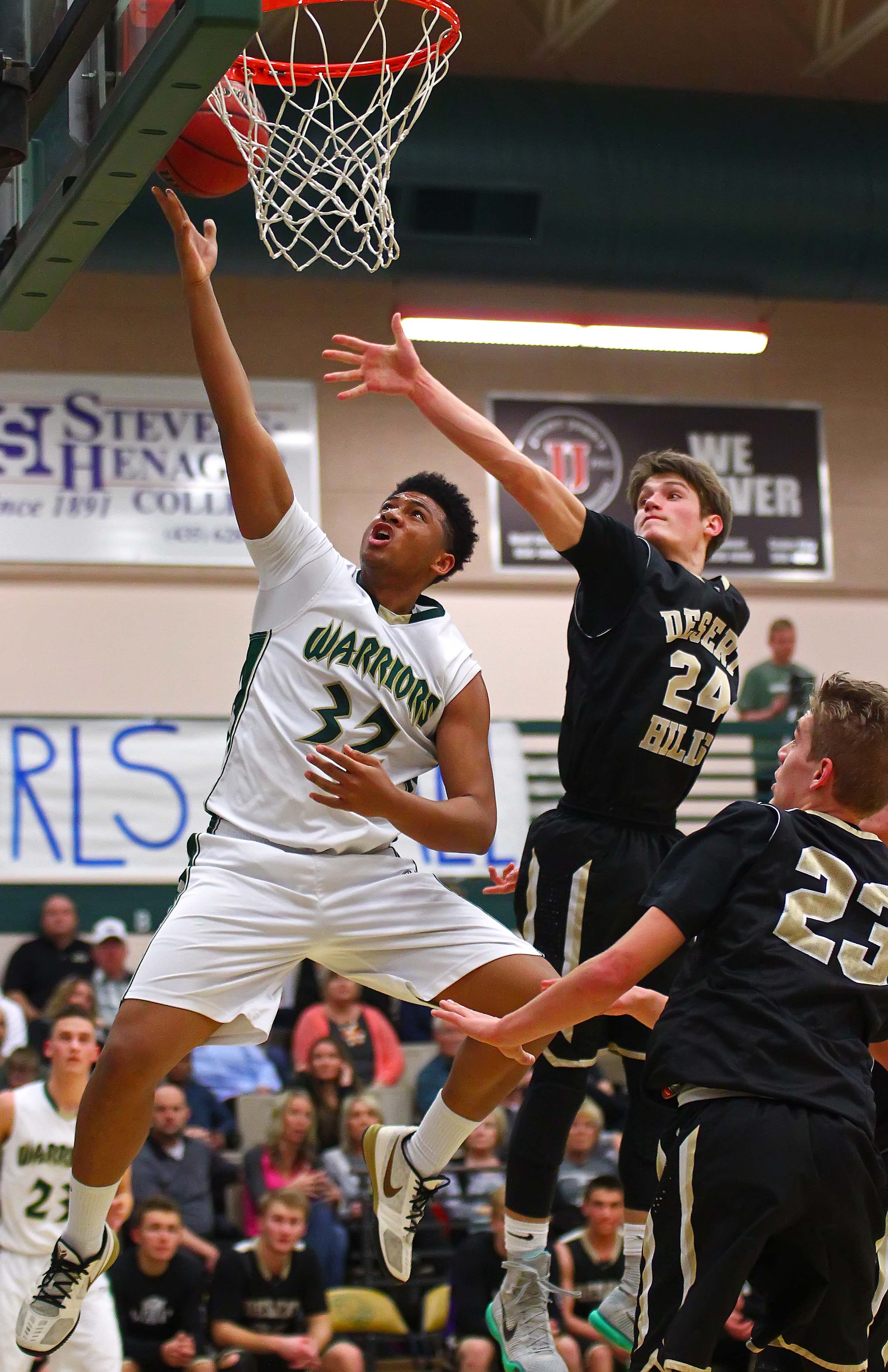 Snow Canyon's Kobe Tupu (32) and Desert Hills' Tanner Turley (24), Snow Canyon vs. Desert Hills, Boys Basketball, St. George, Utah, Jan. 27, 2016, | Photo by Robert Hoppie, ASPpix.com, St. George News