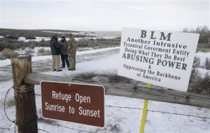 In this file photo, Members of the group occupying the Malheur National Wildlife Refuge headquarters stand guard outside. Thousands of archaeological artifacts and maps detailing where more can be found are stored at a national wildlife refuge currently being held by a group of armed protesters, Burns, Ore., Jan. 4, 2016 | AP Photo by Rick Bowmer, St. George News
