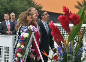 After placing a wreath, daughters and sons of astronauts who have died look up at the names of their loved ones on the Astronaut Memorial during a Day of Remembrance Ceremony on the 30th anniversary of the 1986 space shuttle Challenger tragedy. From foreground are Sheryl Chaffee, daughter of Apollo 1 astronaut Roger Chaffee who died in the Apollo 1 fire on Jan. 27, 1967; Kathie Scobee Fulgham and Air Force Maj. Gen. Richard Scobee, children of Challenger commander Dick Scobee who died on Jan. 28, 1986; and Scott McAuliffe, son of Challenger schoolteacher Christa McAuliffe. Kennedy Space Center Visitor Complex, Jan. 28, 2016 | Photo by Tim Shortt for Florida Today via AP, St. George News