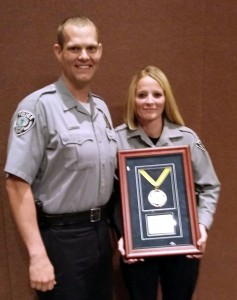 LaVerkin Police Chief Benjamin Lee presents officer Amber Crouse the Outstanding Small Agency Officer of the Year award. LaVerkin, Utah, April 25, 2015 | Photo courtesy of LaVerkin Police Department, St. George News