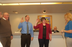 L-R Reelected councilman, Ron Densley, newly elected councilman, Dennis Mehr, newly elected councilwoman, Jenny Johnson being sworn in by Ivins City Recorder, Kari Jimenez, Ivins, Utah, January 7, 2016 | Photo by Hollie Reina, St. George News