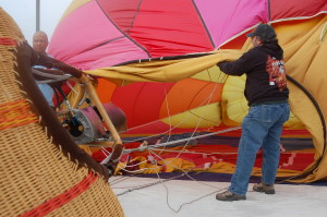 "A hot air balloon crew inflates ""No Worries!!"" in the Oasis parking lot during the ""Mesquite Hot Air Balloon Festival,"" Mesquite, Nevada, January 23, 2016 