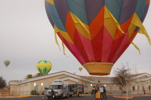 """The """"No Worries!!"""" crew, pilot and passengers after the flight. """"Mesquite Hot Air Balloon Festival,"""" Mesquite, Nevada, January 23, 2016   Photo by Hollie Reina, St. George News"""
