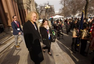 Jackie Biskupski exits a city building prior to a ceremony to swear her in as mayor.. Biskupski is Salt Lake City's first openly gay mayor. Salt Lake City, Jan. 4, 2016   Photo courtesy of Scott G Winterton of The Deseret News via AP, St. George News