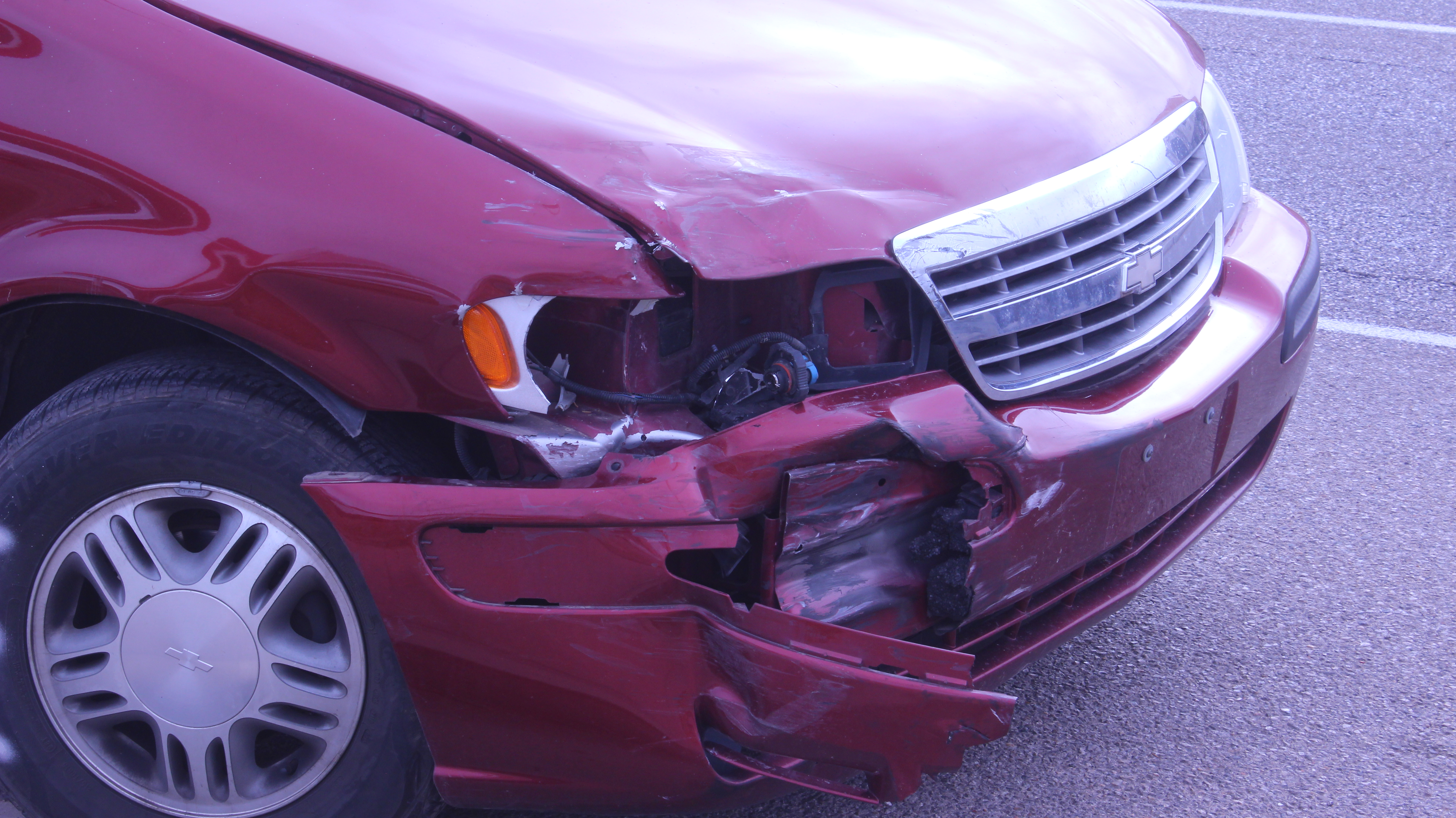 Closeup of the damage sustained by a maroon Chevy Venture minivan in a two-vehicle collision on State Street in Hurricane, Utah, Jan. 18, 2016. | Photo by Don Gilman, St. George News
