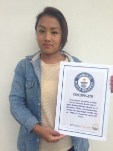 Ngim Sherpa holds her Guinness World Record certificate. Location and date not specified.   Photo courtesy Ngim Sherpa, St. George News