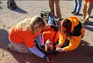 Red Rocks Search and Rescue St. George branch learning to tie a victim into a stokes litter during training, St. George, Utah, November 2015 | Photo courtesy of Red Rocks Search and Rescue, St. George News