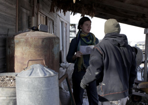 Sara Patterson give a list of chores to a volunteer on the farm before getting started on her own chores, Red Acre Farm CSA, Cedar City, Utah, Jan. 13, 2016 | Photo by Carin Miller, St. George News