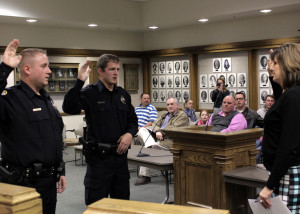 City Recorder Renon Savage swears in Cedar City's newest police officers Stenson Bergstrom and Aemonn Taylor, City Council Chambers, Cedar City, Utah, Jan. 13, 2016 | Photo by Carin Miller, St. George News