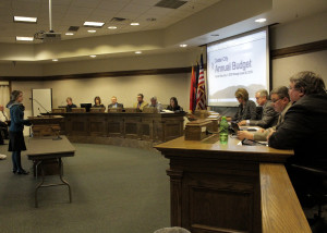Cedar City intern and Cedar High School senior Kristen Arnell presents the 2015-2016 Annual Budget document she compiled to City Council and administrators, Council Chambers, Cedar City, Utah, Jan. 20, 2016 | Photo by Carin Miller, St. George News