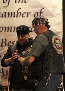 Bikers Against Child Abuse members Madqat and Jurzee check out their award for Organization of the Year at the 65th Annual Best of Cedar City Awards Gala, Southern Utah University Ballroom, Cedar City, Utah, Jan. 20, 2016 | Photo by Carin Miller, St. George News