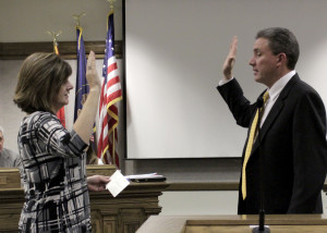 Returning Councilman Paul Cozzens takes his oath of service Wednesday night before a room full of onlookers, Cedar City Council Chambers, Cedar City, Utah, Jan. 06, 2016 | Photo by Carin Miller, St George News