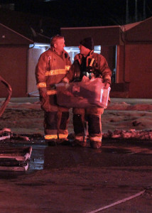Firefighters help carry out bins with residents belongings in them, 100 W. 200 South area, Cedar City, Utah, Jan. 6, 2016 | Photo by Carin Miller, St. George News