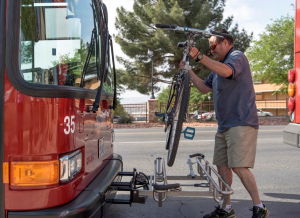 A SunTran rider uses the bike racks to transport his bike to his stop, St. George, Utah, date not specified | Photo by Dave Becker, St. George News