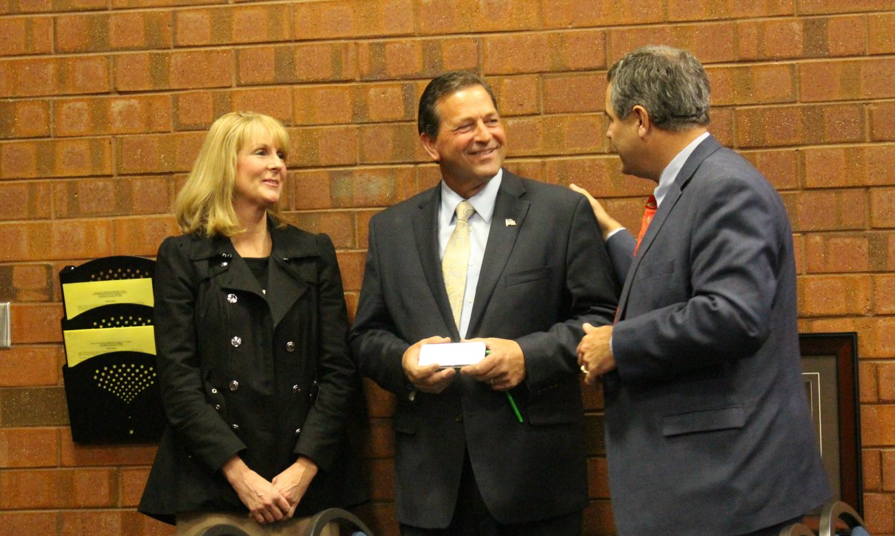 JIll and Gil Almquist with St. George Mayor Jon Pike at the the last St. George City Council meeting of 2015. Prior to the meeting, City Council members and city staff had a going away party for the outgoing Councilman Almquist, St. George, Utah, Dec. 17, 2015 | Photo by Mori Kessler