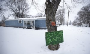 A sign referencing Ammon Bundy and his brother, who are the sons of Nevada rancher Cliven Bundy, hangs on a tree in front of a home Tuesday. Ammon Bundy, the leader of a small, armed group that is occupying a remote national wildlife preserve in Oregon said Tuesday that they will go home when a plan is in place to turn over management of federal lands to locals, Burns, Orgeon, Jan. 5, 2016 | AP Photo/Rick Bowmer, St. George News