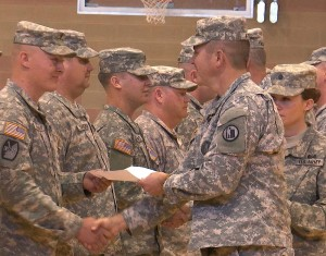 Brig. Gen. Dallen Atack, Utah National Guard, congratulates a soldier honored at a ceremony Sunday, St. George, Utah, January 10, 2016   Photo by Austin Peck, St. George News
