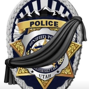 A police badge with a banner indicating a police officer has fallen | Photo courtesy of the Unified Police Department, St. George News