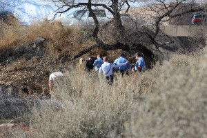Officials examine a body found by City Creek Thursday, St. George, Utah, Jan. 14, 2016 | Photo by Ric Wayman, St. George News