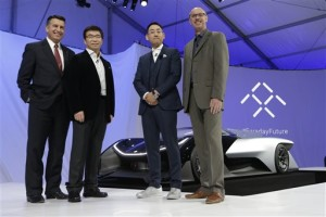 Nevada Gov. Brian Sandoval, left, poses for a photo in front of the FFZero1 by Faraday Future, alongside members of the Faraday Future team at CES Unveiled, a media preview event for CES International Monday, Jan. 4, 2016, in Las Vegas. The high-performance electric concept car was unveiled during a news conference by Faraday Future. From right are Nick Sampson, product developer, Richard Kim, head of global design, Ding Lei, and letv co-founder | AP Photo/Gregory Bull, St. George News