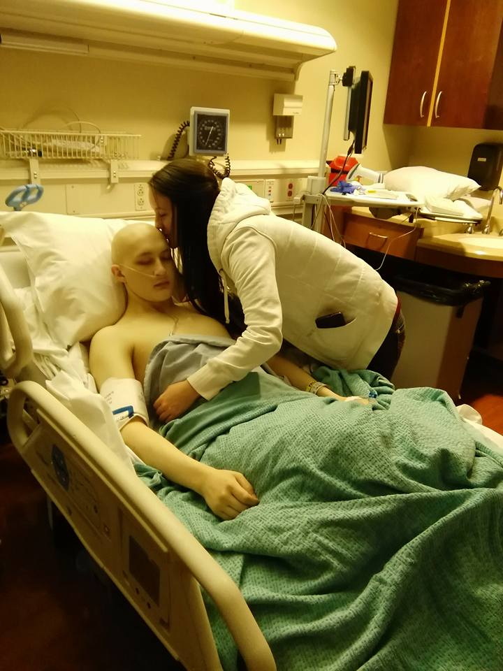 Derek Hoyt's sister leans in for a kiss as her brother is in recovery from a pain pump installation, Huntsman Cancer Institute, Salt Lake City, Utah, Nov. 25, 2015 | Photo courtesy of Kirsten Catella, St. George News