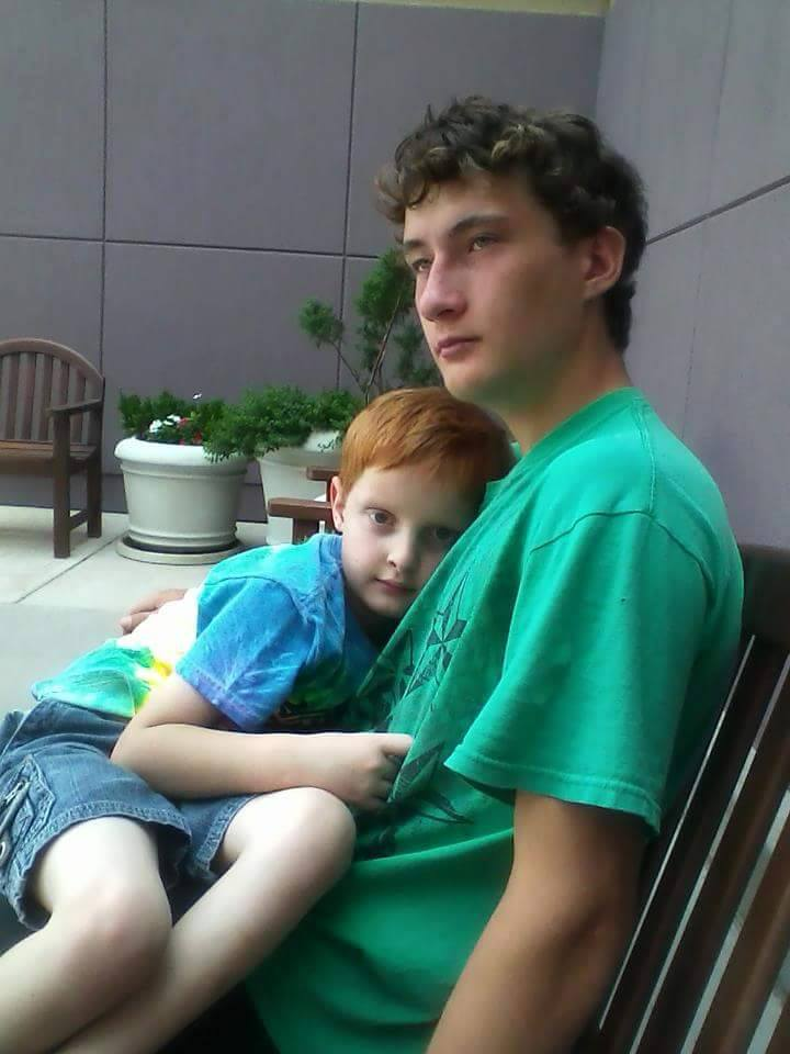 Derek Hoyt and his little brother rest on a bench outside of the mall, Red Cliffs Mall, St. George, Utah, date not specified | Photo courtesy of Kirsten Catella, St. George News