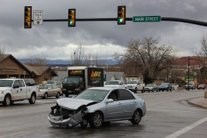A car sits damaged in an intersection after running a red light and striking another car, Washington, Utah, January 6, 2016 | Photo by Ric Wayman, St. George News