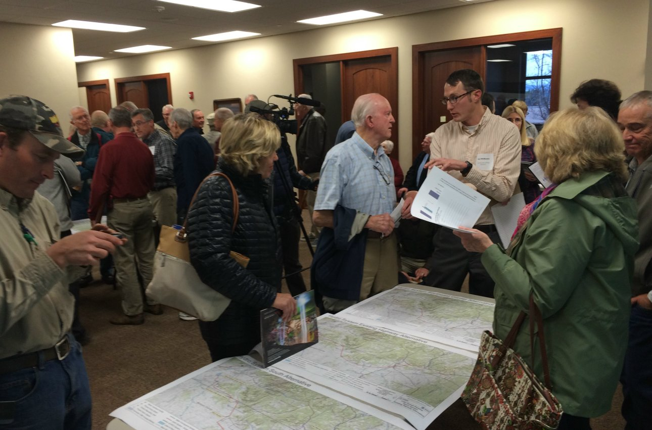Joel Williams (light striped shirt and glasses at far right), of the Utah Division of Water Resources, answers questions about the Lake Powell Pipeline project at an open house held at the Washington County Water Conservancy District Wednesday night. St. George, Utah, Jan. 13, 2016 | Photo by Mori Kessler, St. George News