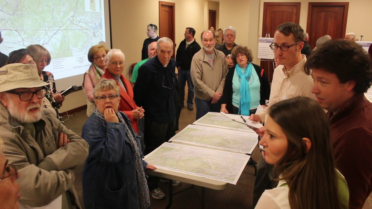 People attending an open house held at the Washington County Water Conservancy District Wednesday night ask questions about the potential costs of the Lake Powell Pipeline project. St. George, Utah, Jan. 16, 2016 | Photo by Mori Kessler, St. George News