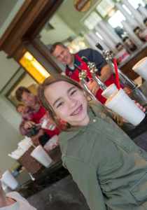 In this photo from 2015 a young girl enjoys a root beer float during St. George Heritage Day, St. George, Utah, January, 2015 | Photo by Dave Becker, St. George News