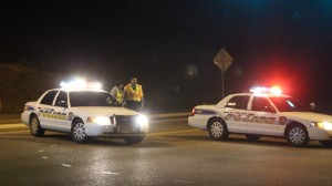 Two police units block access to Red Hills Parkway at the Skyline Drive intersection as responders deal with an accident on the east side of the Dixie Rock, St. George, Utah, Jan. 27, 2016 | Photo by Mori Kessler, St. George News