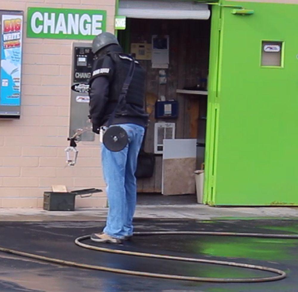 Bomb Squad Removes Suspicious Device From Car Wash