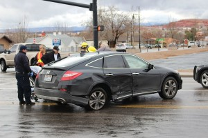 A woman is removed from her damaged car after being hit by a driver that ran a red light, Washington, Utah, Jan. 6, 2016 | Photo by Ric Wayman, St. George News