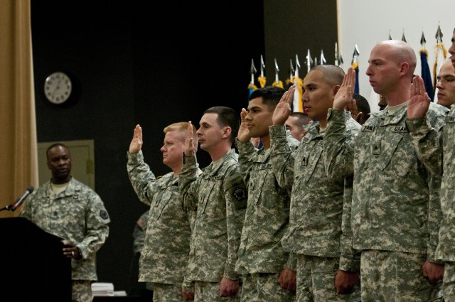 """In this November 2011 photo, 28 sergeants from the 864th Engineer Battalion """"some of the Army's newest noncommissioned officers"""" recite the Oath of the United States Army Noncommissioned Officer Nov. 18 during an induction ceremony for the battalion at French Theater on Joint Base Lewis-McChord, Washington, Nov. 21, 2011