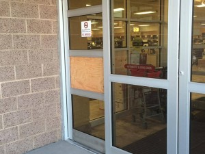 Wood covers where a pane of glass was broken out Friday morning to gain access to the State Liquor Store, St. George, Utah, Jan. 1, 2016   Photo by Mori Kessler, St. George News