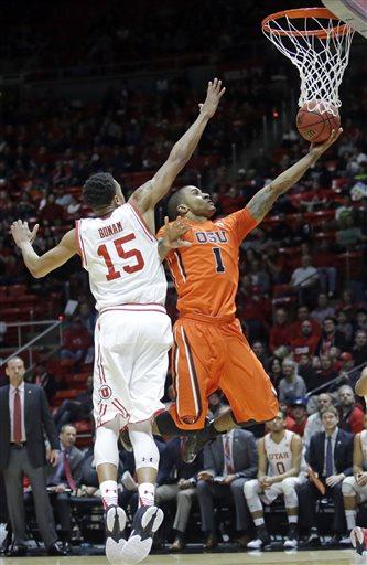 Oregon State guard Gary Payton II (1) goes to the basket as Utah guard Lorenzo Bonam (15) defends during the first half of an NCAA college basketball game Sunday, Jan. 17, 2016, in Salt Lake City. (AP Photo/Rick Bowmer)