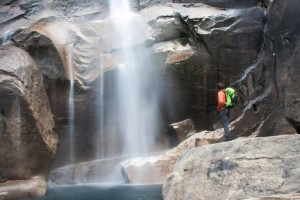 SUU Outdoor Education Series speaker Keith Howells hikes in the mist of the waterfalls, Location and date unspecified | Courtesy of Keith Howells, St. George News