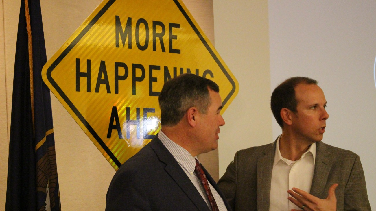 Mayor Jon Pike and area realtor Jeremy Larkin, CEO of the Larkin Group, standing in front of the a traffic sign displaying the City of St. George's branding message. It was also the theme of the mayor's 2016 State of the City address delivered at the St. George Area Chamber of Commerce luncheon. St. George, Utah, Feb. 3, 2016 | Photo by Mori Kessler, St. George News