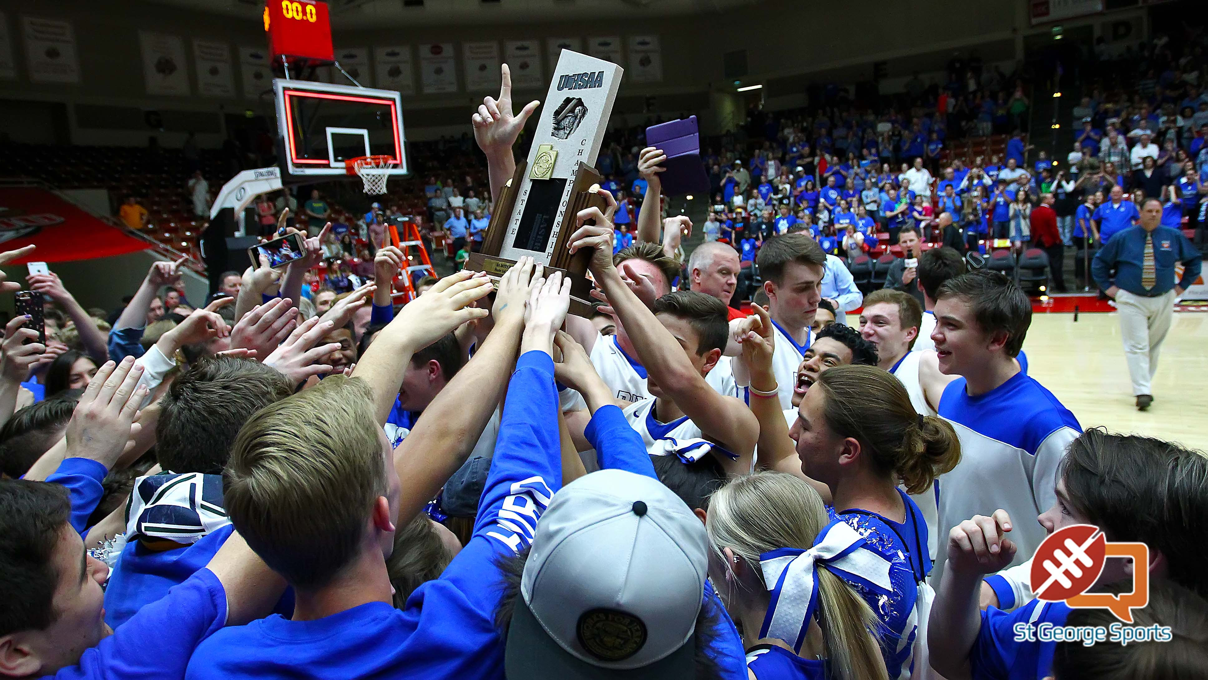 Dixie hoists the state championship trophy, Dixie vs. Juan Diego, 3A State Basketball Tournament, Boys Basketball, Cedar City, Utah, Feb. 27, 2016, | Photo by Robert Hoppie, ASPpix.com, St. George News