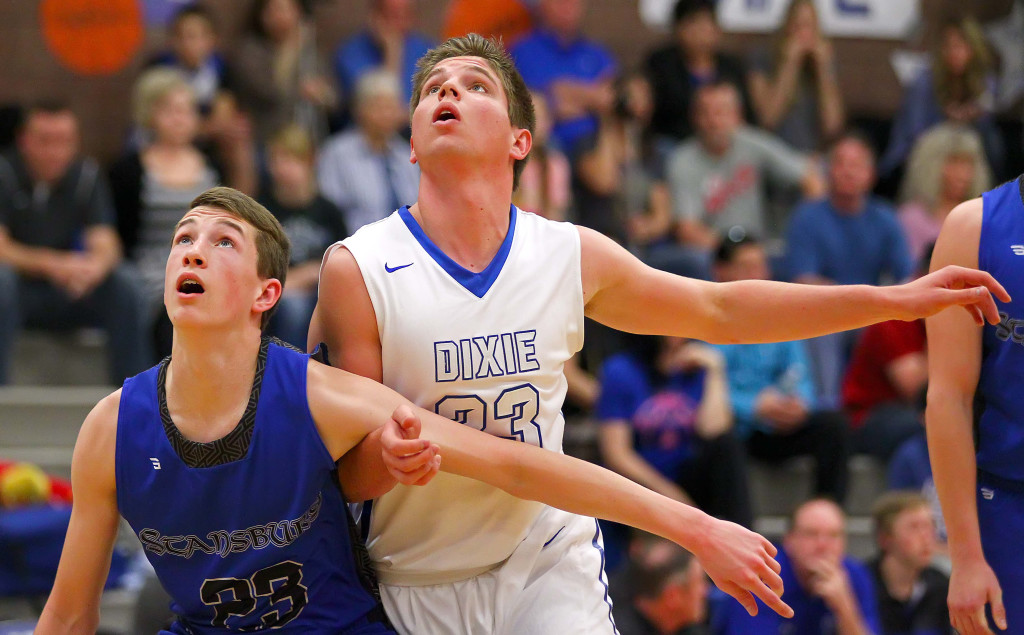 Dixie's James Eardley (23) and Stansbury's Josh Jenkins, Dixie vs. Stansbury, Boys Basketball, St. George, Utah, Feb. 20, 2016, | Photo by Robert Hoppie, ASPpix.com, St. George News