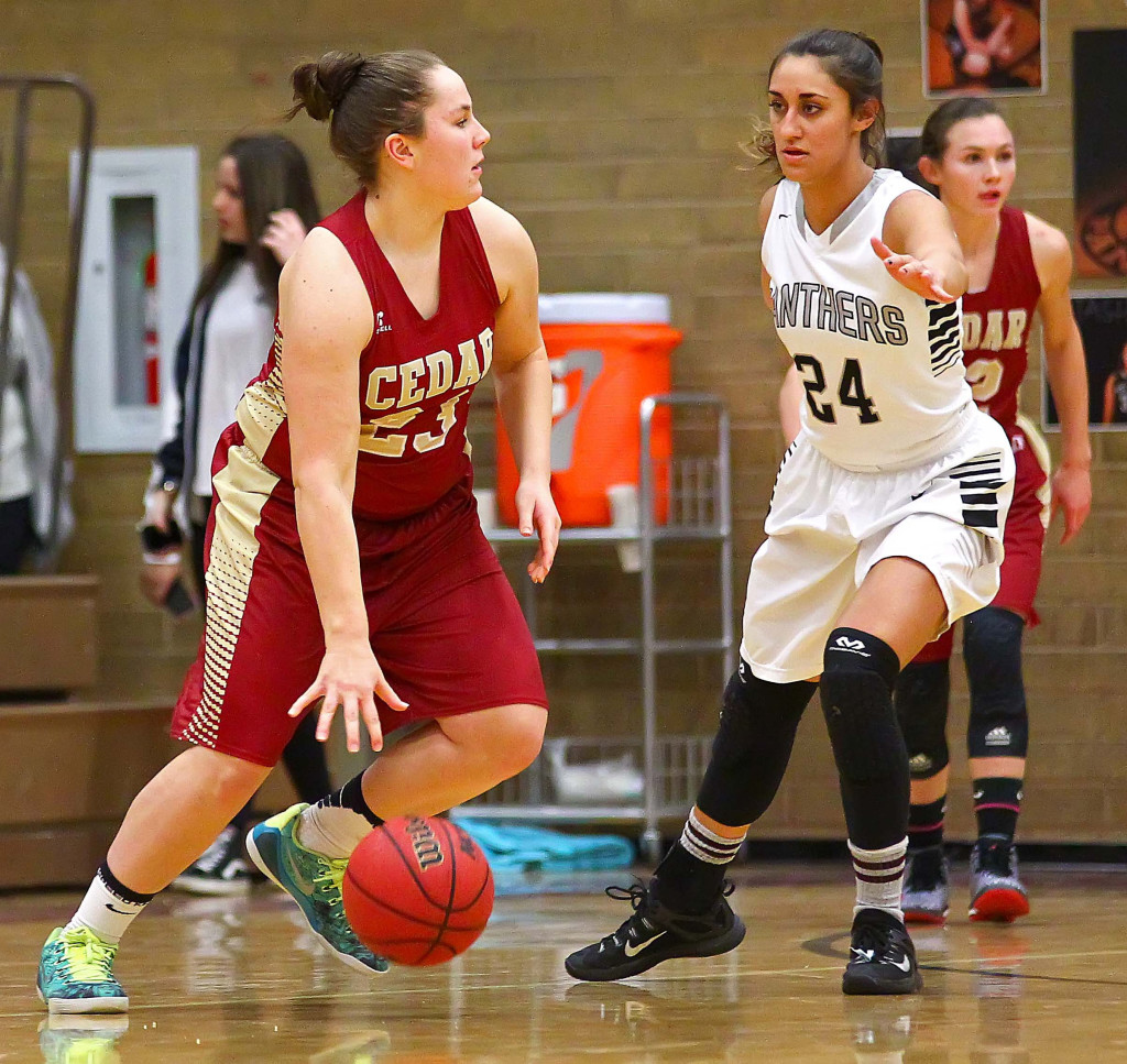Cedar's  Courtney Morley (23) and Pine View's  Tayvia AhQuin (24), Pine View vs. Cedar, Girls Basketball, St. George, Utah, Feb. 4, 2016, | Photo by Robert Hoppie, ASPpix.com, St. George News