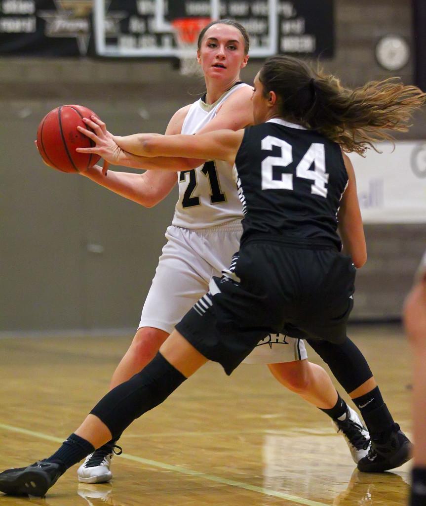 Desert Hills'  Megan Wiscombe (21) and Pine View's  Tayvia AhQuin (24), Desert Hills vs. Pine View, Girls Basketball, St. George, Utah, Feb. 9, 2016, | Photo by Robert Hoppie, ASPpix.com, St. George News