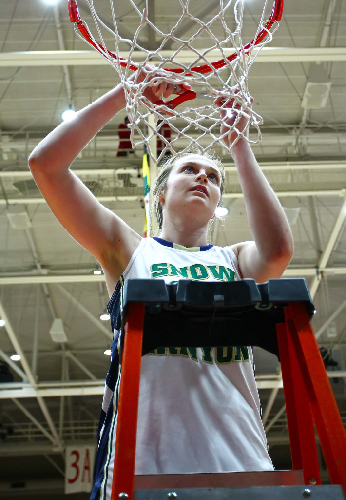 Snow Canyon's  Madison Mooring (21) cuts down the net after winning the state championship, Snow Canyon vs. Cedar, 3A State Basketball Tournament, Girls Basketball, Cedar City, Utah, Feb. 27, 2016, | Photo by Robert Hoppie, ASPpix.com, St. George News