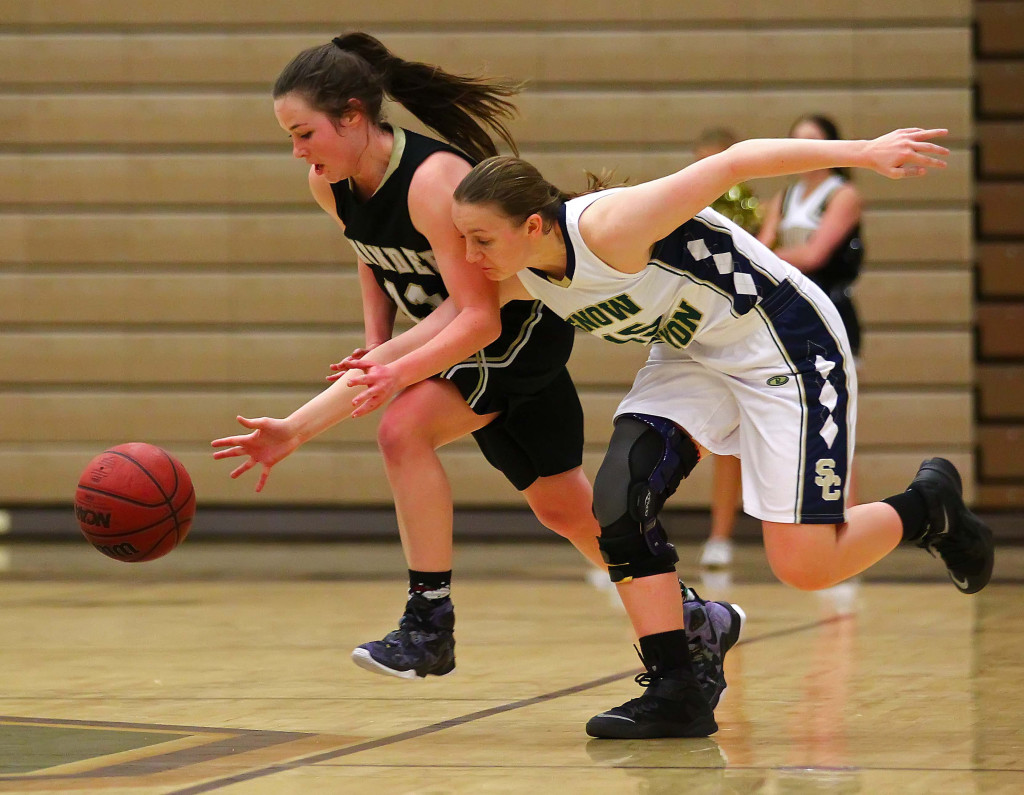 Desert Hills'  Kylie Williams (11) and Snow Canyon's  Natalie Coulam (15), Snow Canyon vs. Desert Hills, Girls Basketball,  St. George, Utah, Feb. 10, 2016, | Photo by Robert Hoppie, ASPpix.com, St. George News