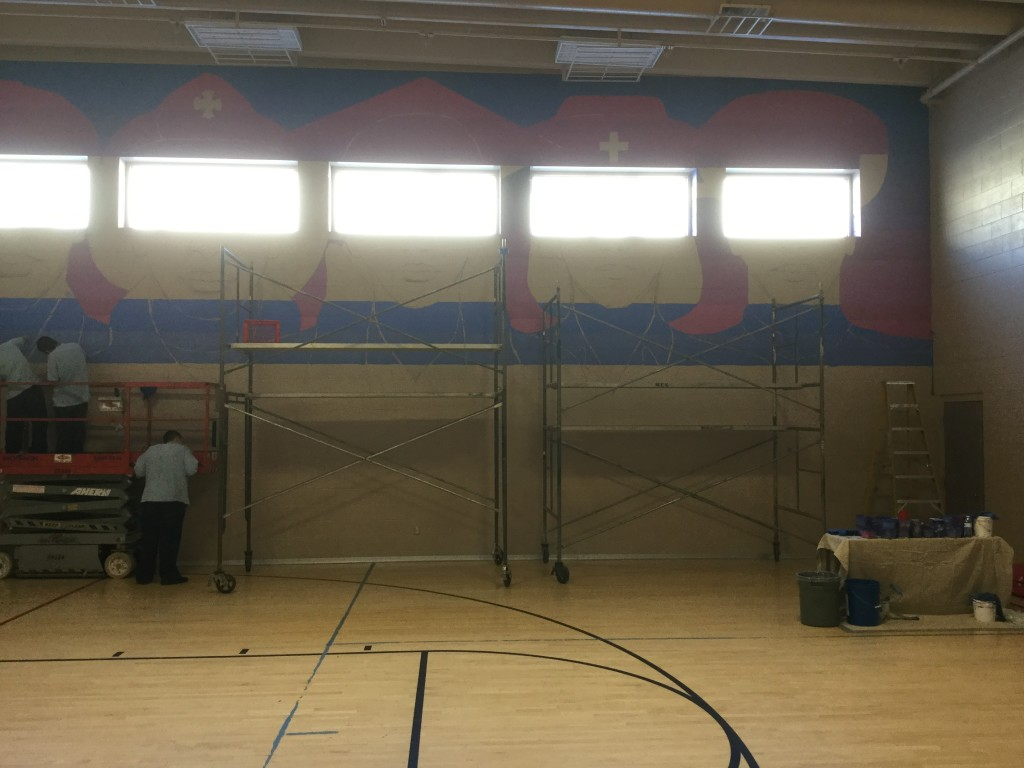 Incarcerated youth at Southwest Utah Youth Center work together to paint a 44-by-24 foot mural, Cedar City, Utah, Date unspecified | Courtesy of the Southwest Utah Youth Center, St. George News